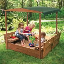 decorating round sandboxes and walkways with outdoor bench also