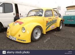 yellow volkswagen beetle royalty free vw beetle drag car volkswagen peoples car stock photo royalty