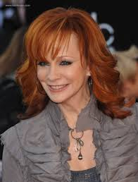 hair colors for 50 plus reba mcentire long chiseled hairstyle for 50 plus redhead women