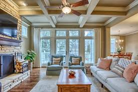 traditional living room with ceiling fan u0026 french doors in