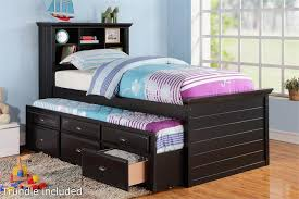 black twin bed with bookcase headboard and trundle with storage