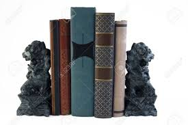lion book ends two carved marble lion bookends supporting a few books stock photo