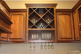 kitchen with built in big x wine rack over plate rack and stemware
