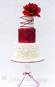 white and red wedding cake with ruffles and peony bellaria cake