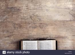Wooden Desk Background Opened Bible On A Wooden Desk Background Stock Photo Royalty Free