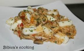 tomates cuisin s poêlée de riz aux calamars chignons et tomates fraîches