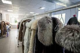 Laundry Room Hangers - image of fur coats on hangers in laundry room stock photo image