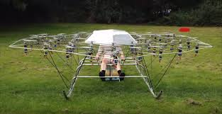 man flies in a lawn chair powered by a huge diy multi rotor drone