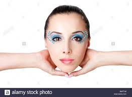 beautiful female fashion face with blue makeup and gems