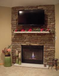 interior impressive rocks fireplace design with standing chandle