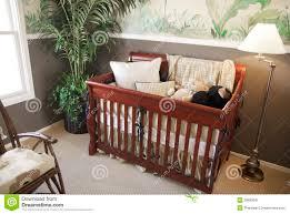 cherry wood baby crib in nursery interior stock image image