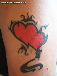 sweet and mystic colored little heart tattoo on leg tattoo wf
