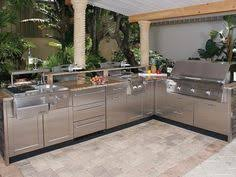 this large l shaped outdoor kitchen design includes paneled
