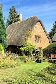 The Cotswolds Cottages by Hills In With Field Of Poppies Near Leafield Cotswolds Uk