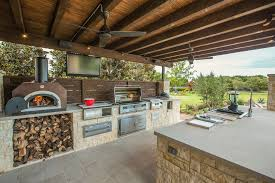 green egg outdoor kitchen for traditional patio with stacked stone