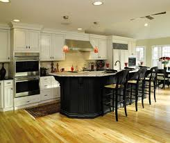 off white cabinets with black kitchen island decora