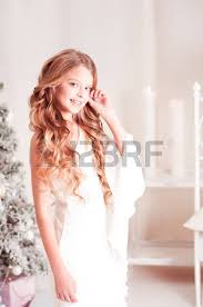 long hair on 66 year old smiling teen girl 14 15 year old with blonde curly hair looking