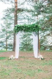wedding arches branches picture of lush greenery wedding arch with flowy curtains and candles