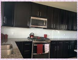 image of white subway tile backsplash with dark cabinets