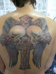 back skulls cross wings tattoo