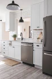 email post kitchens black cabinet and wood planks