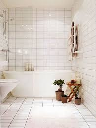 white tiled bathroom ideas a shower bathtub combo in a small space bathroom remodel