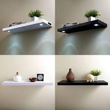 under cabinet led lighting puts the spotlight on the modern rechargeable led floating shelf illuminated wooden shelves on