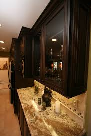 chagne bronze cabinet hardware traditional kitchen with cherry cabinetry