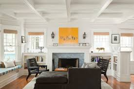 modern bookshelves around fireplace living room beach style with