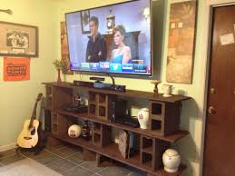 diy shelves cinder blocks 1x8 and 1x6 pine board per shelf