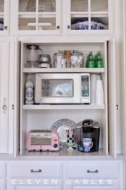 the kitchen cabinet company eleven gables hidden appliance cabinet and desk command center in