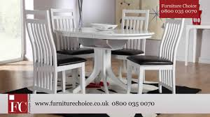 Extending Dining Table And Chairs Uk Hudson White Round Extending Dining Table From Furniture Choice