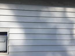 how to replace an exterior window with vinyl siding