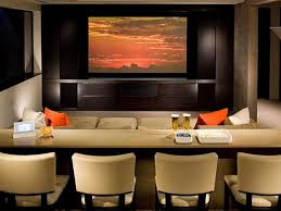 cool home theater ideas home theater showing large lcd on the wall and cream fabric chairs