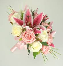 bouquet of lilies brides pink silk stargazer ivory wedding bouquet