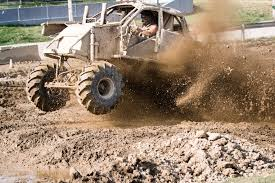 monster trucks racing in mud mud sweat and gears monster truck drivers hit the dirt track