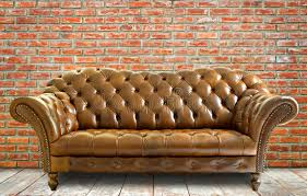 The Brick Leather Sofa Vintage Style Leather Sofa With Wooden Floor And Brick Wall Stock