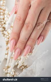 painted extreme long nails hands pearl stock photo 274715045