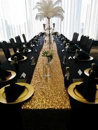 black table linens gold charger plates black napkins pyramid