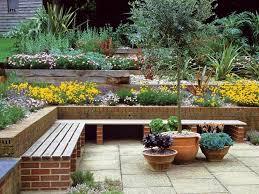 delightful terraced flower garden design with l shape garden bench