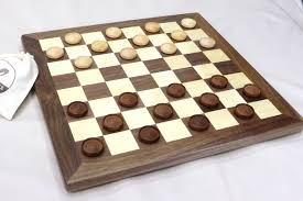 buy a handmade walnut and maple checkers chess board with carved