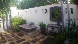 bathroom dazzling outside with stone pavers and white bathroom dazzling outside with stone pavers and white concrete fence also antique vanity