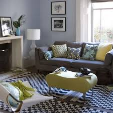 good way to bring in the blue and yellow with the charcoal couches