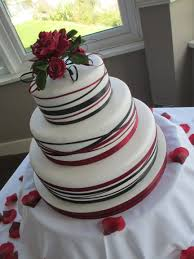 white red and black ribbon wedding cake with sugar roses cakes