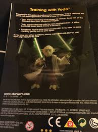 star wars legendary yoda from spinmaster will kick your