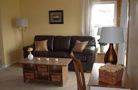 Brown Themed Living Room by Tuscan Inspired Living Room Brown Color Arm Rest Chairs Soft And