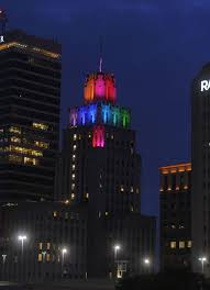 kimpton cardinal hotel displays rainbow colored lights to honor