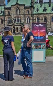 Seeking Ottawa Tourists Seeking Advice From A Guide In Ottawa Editorial Image