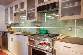 smoke gray glass subway tile backsplash in bright kitchen design