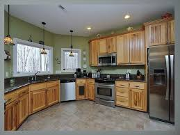 what paint color goes best with hickory cabinets pin on renovated house family room hickory kitchen